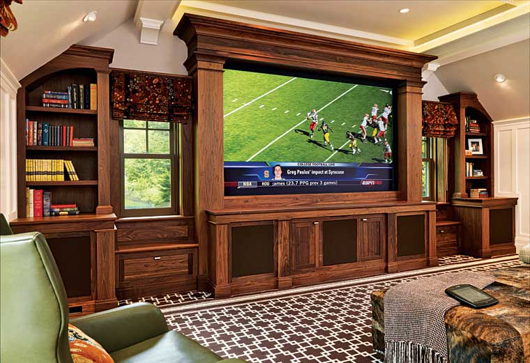 Custom walnut built-in entertainment center.