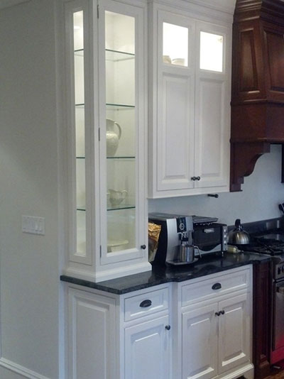 Custom kitchen cabinets with wood range hood.