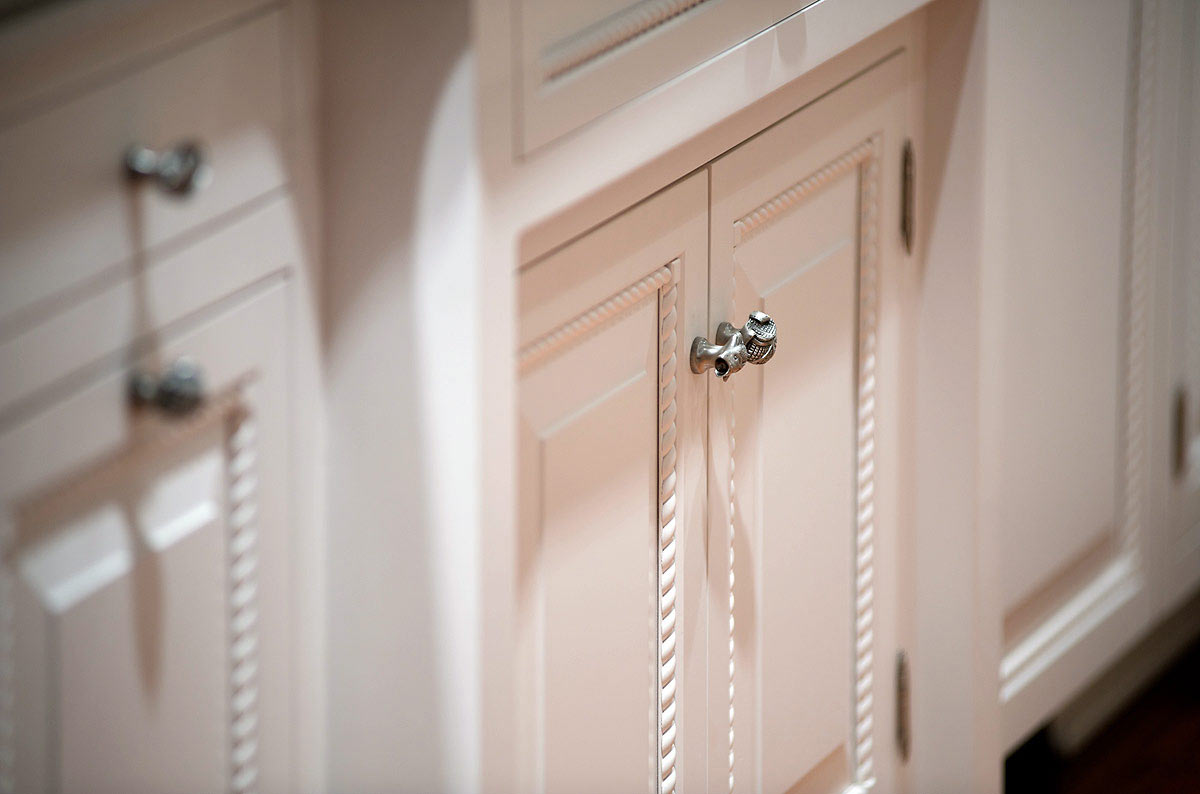 Close up image of cabinet door with rope molding detail.