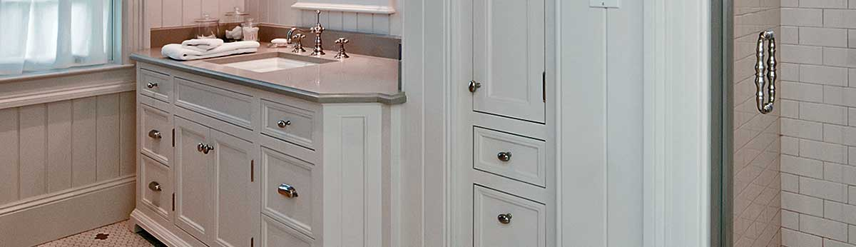 Cape Cod style bathroom with custom white painted cabinets.