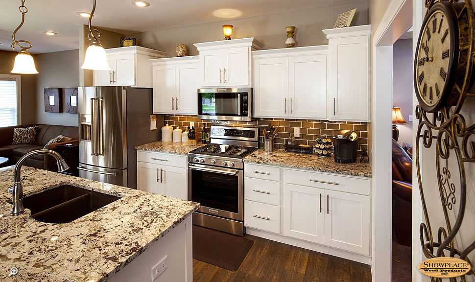 White cabinets full overlay door style.