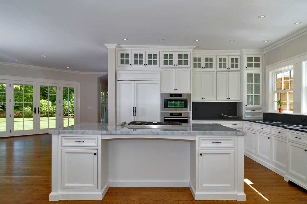 Custom White kitchen cabinets with custom island