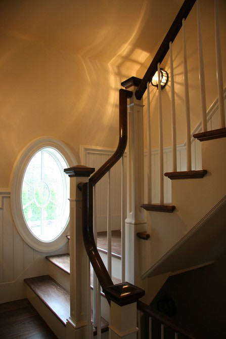 Toby Leary custom stairway with curved handrail.